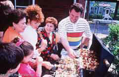 Family at a barbecue; Size=240 pixels wide